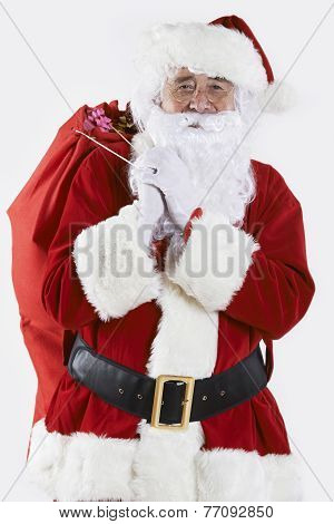 Santa Claus Carrying Sack Filled With Gifts