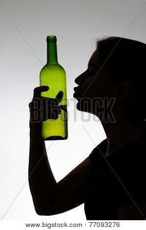 Alcoholic Woman Kissing A Wine Bottle