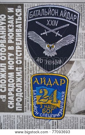 Kiev,Ukraine.Oct 16.Illustrative editorial.Pro-Ukran ian nationalist formations Aydar chevrone .Newspaper with heroic story of soldier as background.At October 16,2014 in Kiev, Ukraine