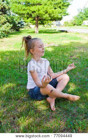 Cute Girl In Lotus Pose With Sore Knee