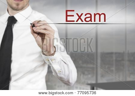 Businessman Writing Exam