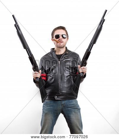 Man In Black Leather Jacket And Sunglasses With Two Shotguns