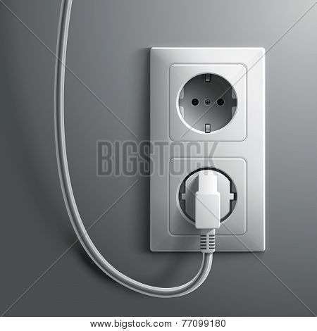 Electric white plug and socket on grey wall background