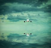 foto of surrealism  - airplane into a surreal colorful evening sky with reflection - JPG