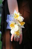 picture of traditional attire  - Closeup view of a floral corsage displayed vertically on the arm of a high school girl attending her prom - JPG