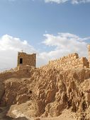 picture of masada  - Masada is the name for a site of ancient palaces and fortifications in the South District of Israel on top of an isolated rock plateau overlooking the Dead Sea - JPG