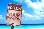 stock photo of persistence  - Follow Your Passion sign with a beach on background - JPG