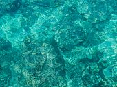 foto of homogeneous  - Abstract image of clear turquoise sea water filling the picture - JPG
