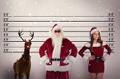 picture of mug shot  - Santa Claus wears black sunglasses against mug shot background - JPG