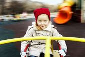 foto of merry-go-round  - Cute little girl rounding on merry - JPG
