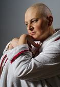 stock photo of night gown  - Bald woman suffering from cancer sitting lost in thoughts - JPG