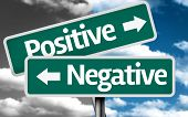 stock photo of positive negative  - Positive x Negative creative sign with clouds as the background - JPG