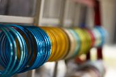 stock photo of bangles  - multicolor bangles arranged and displayed in the waiting customers. ** Note: Shallow depth of field - JPG