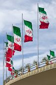 foto of tehran  - Rows of waving Iranian flags on a street bridge in Tehran against Cloudy Blue Sky - JPG