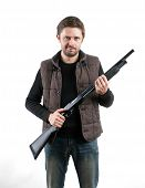 picture of shotgun  - Brutal man with shotgun on white background - JPG