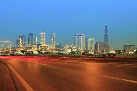 picture of fuel tanker  - beautiful city scape of road and land transportaiton against lighting of oil refinery industry plant use as energy and fuel power topic background - JPG