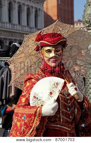 Masked Woman In Red Costume With Umbrella And Fan, Venice