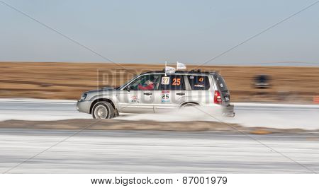 Silver subaru Forester on ice track