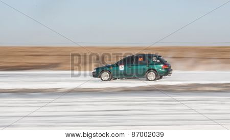 Green subaru Impreza on ice track