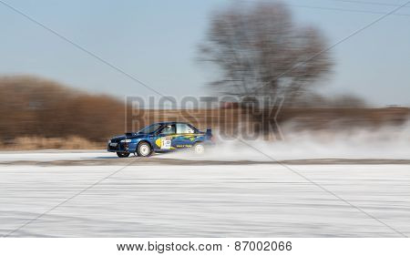 Blue subaru Impreza on ice track