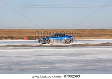 Blue subaru BRZ on ice track