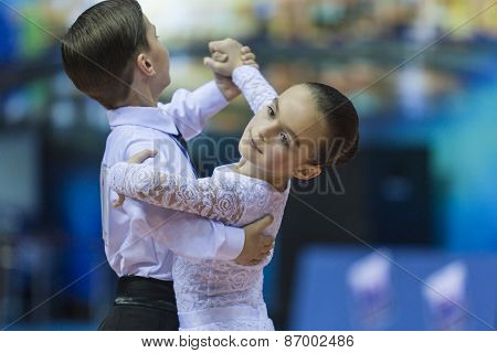 Minsk, Belarus -February 15, 2015: Unidentified Professional Dance Couple Performs Juvenile-1 Standa
