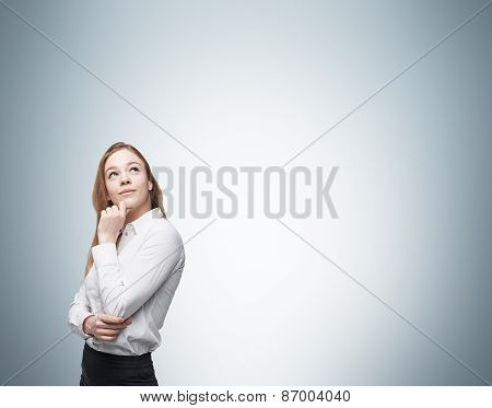 Young Business Lady Is Thinking About Something.