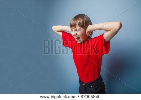 teenager boy brown European appearance in a red shirt covered hi