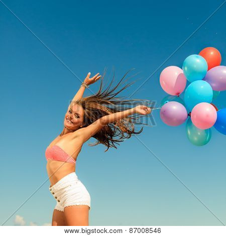 Girl Jumping With Colorful Balloons On Sky Background