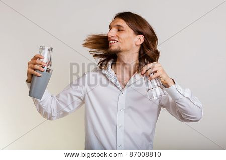 Young Man With Shaker Making Cocktail Drink