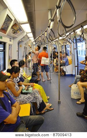 Passengers Ride On A Metropolitan Rapid Transit (mrt) Subway Train In Bangkok