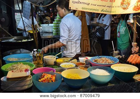 An Unidentified Street Vendor Cooks Pad Thai In Bangkok