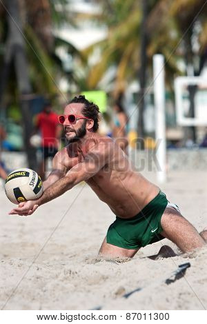 Ball Hits Lunging Player's Arms In Miami Beach Volleyball Game
