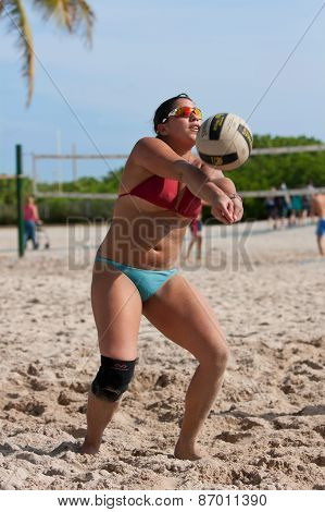 Female Plays Pickup Game Of Beach Volleyball In Miami