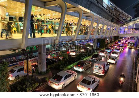 BANGKOK, THAILAND, DECEMBER 25, 2014: View on the aerial BTS walking platform and the transportation traffic in Sukhumvit road in Bangkok, Thailand