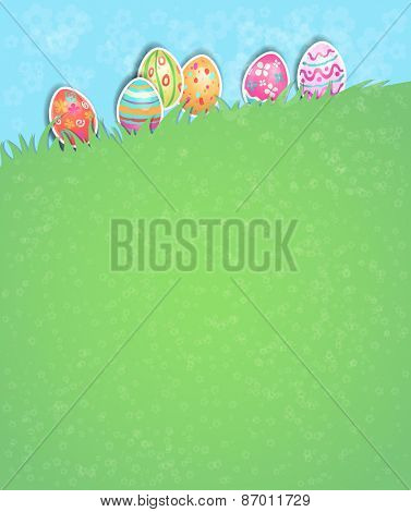 Easter eggs on grass. Holiday card with place for text.
