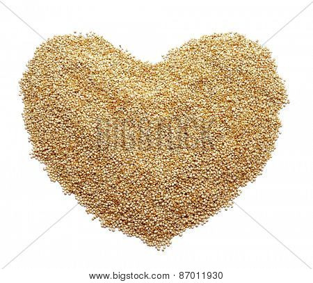 a pile of quinoa seeds forming a heart on a white background