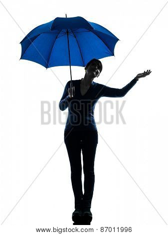 one  woman holding umbrella umbrella palm gesture in silhouette studio isolated on white background