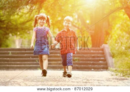 Happiness brother and sister fun outdoor under sunlight