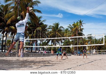 Man Hits Jump Serve In Miami Pickup Beach Volleyball Game