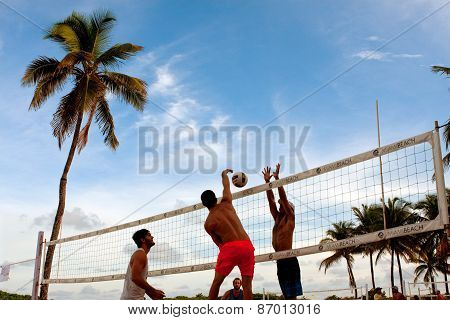 Man Spikes Ball Past Blocker In Miami Beach Volleyball Game