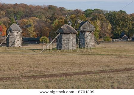 Country Scenery. Autumn. Three Windmills In The Field.
