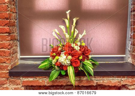 Bouquet Of Red Amarillis On A Window Sill