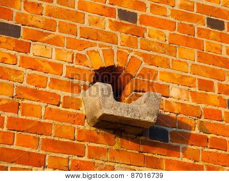 Historical gutter in the brick wall