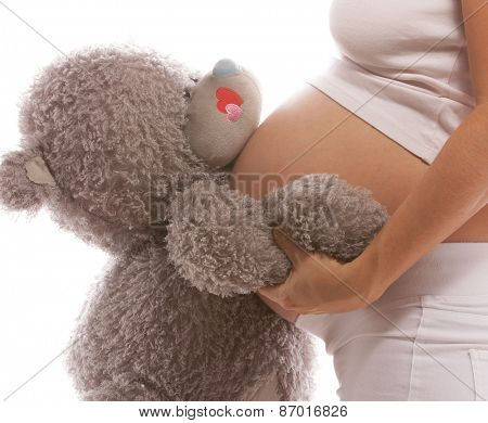 pregnant caucasian woman closeup body isolated on white background studio shot belly