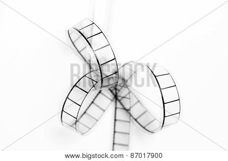35Mm Movie Film Bow Closeup, Black And White On White Background