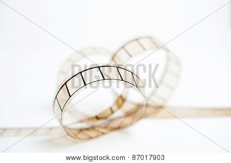 35Mm Movie Film Bow Closeup On White Background
