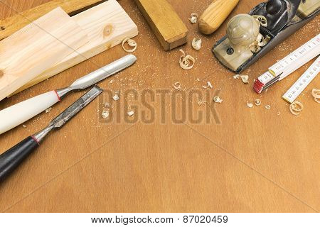 Chisels And Plane With Shavings On Wooden Background