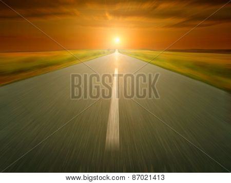 Empty Asphalt Road At Sunset In Motion Blur