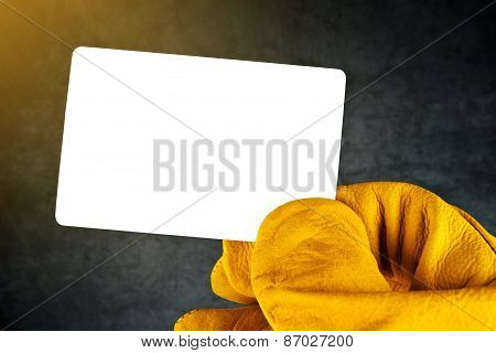 Hand In Leather Construction Working Gloves Holding Blank Business Card